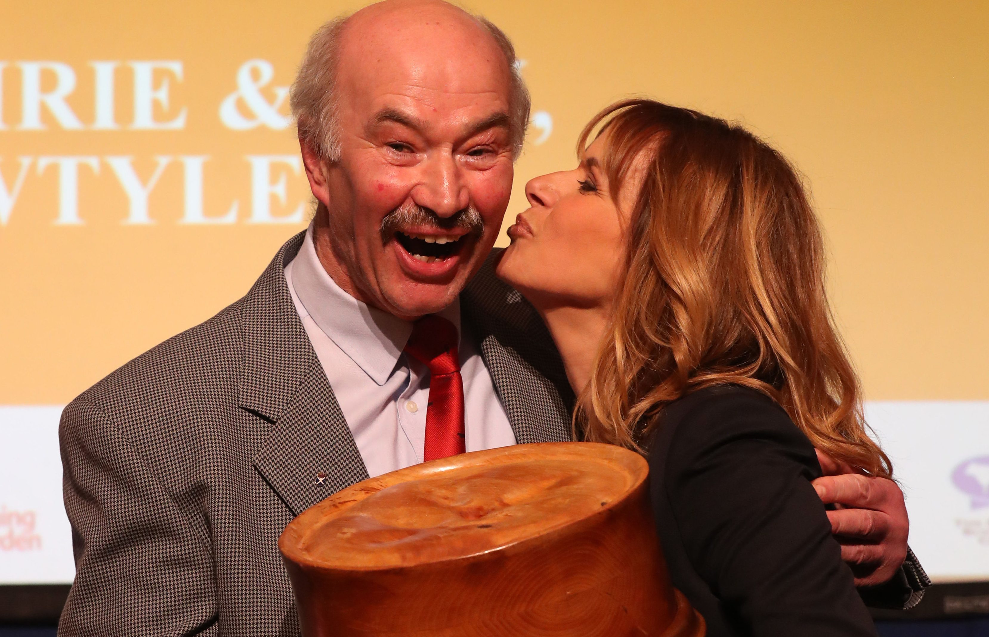 Alan Pirie is congratulated by host Carol Smillie after winning the World Champion Scotch Pie award