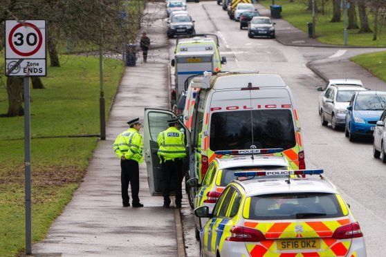 Several Police and vehicles at address on Firbank Road, Letham area of Perth.