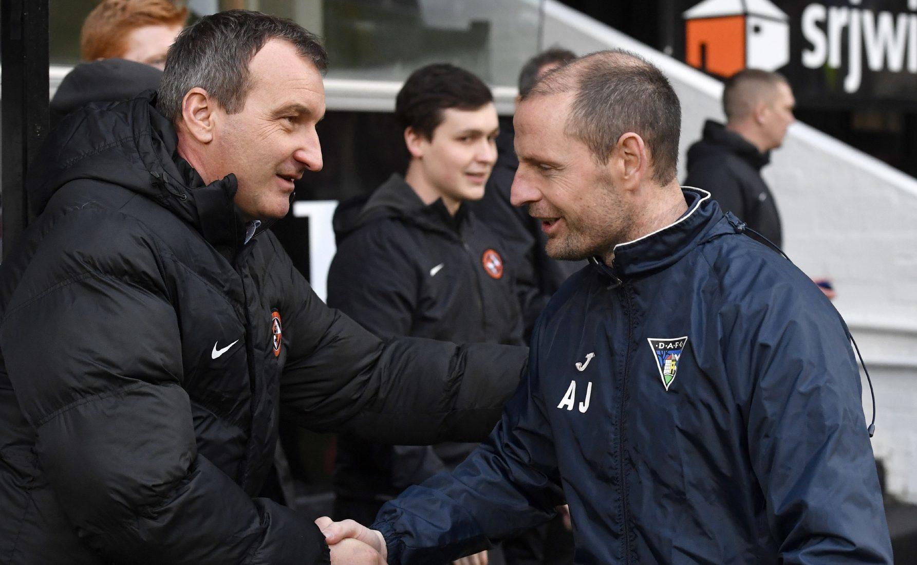 Csaba Laszlo and Allan Johnston shake hands.