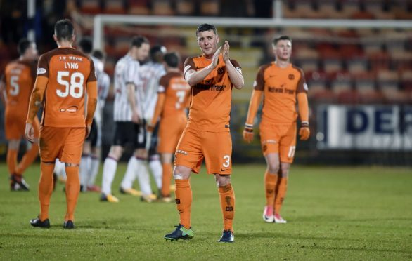 Tam Scobbie applauds the United fans after the draw at Dunfermline.
