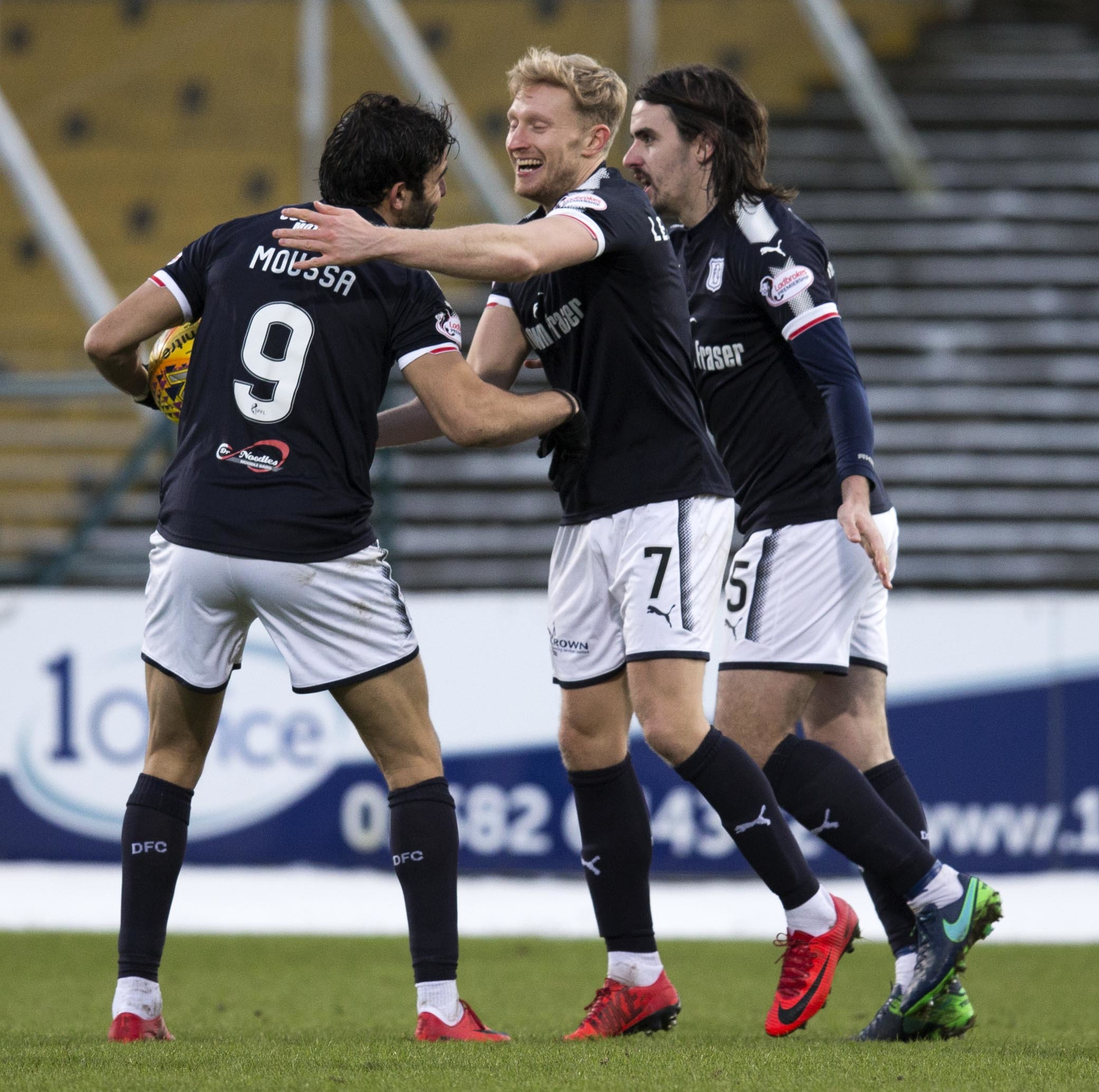 The Dundee player celebrate their first goal.