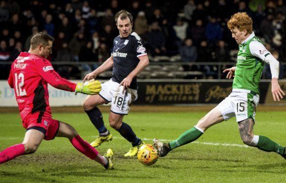 Elliot Parish saves from Hibs striker Simon Murray.