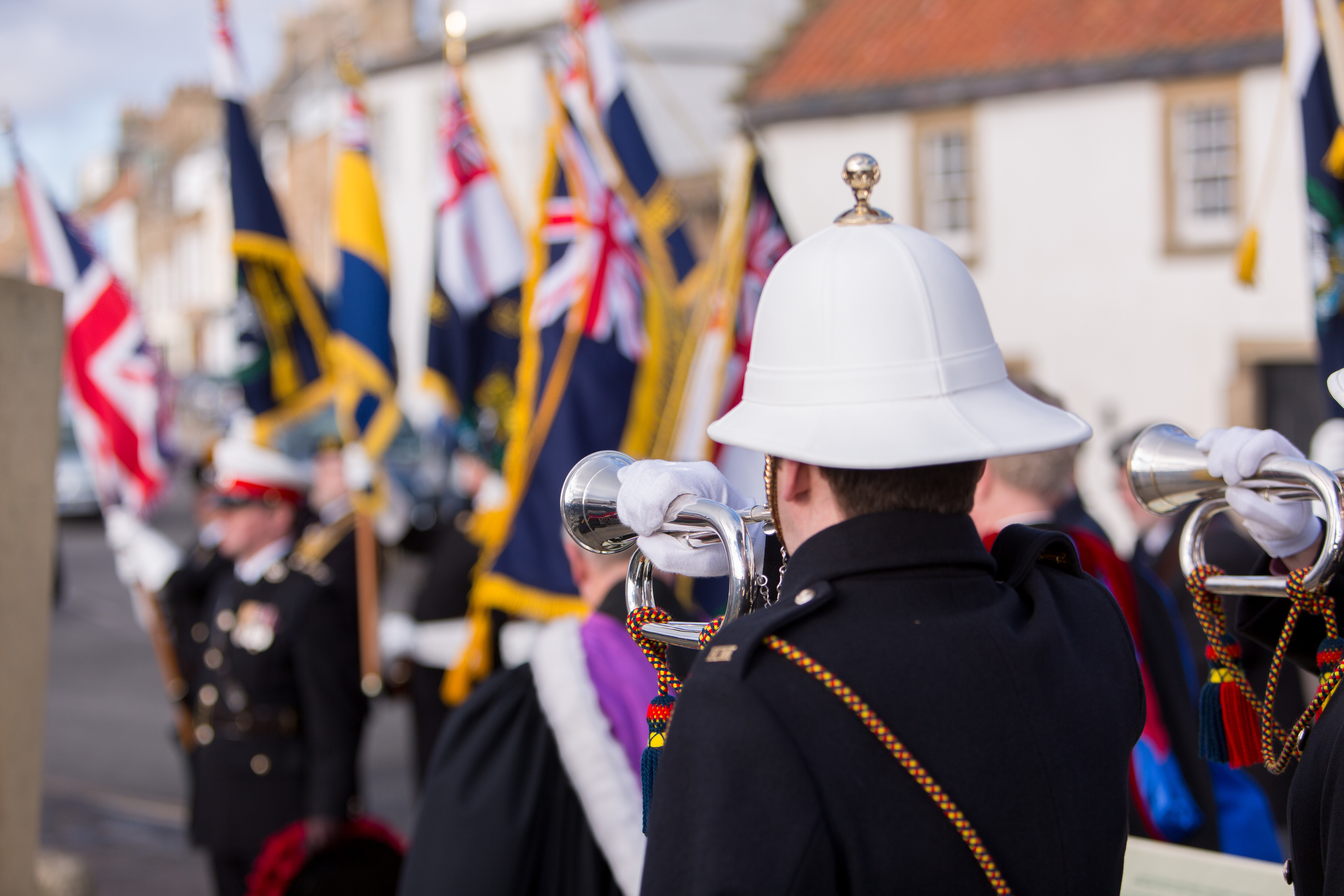 Dignitries and Armed Forces attend memorial service on the shore in Anstruther