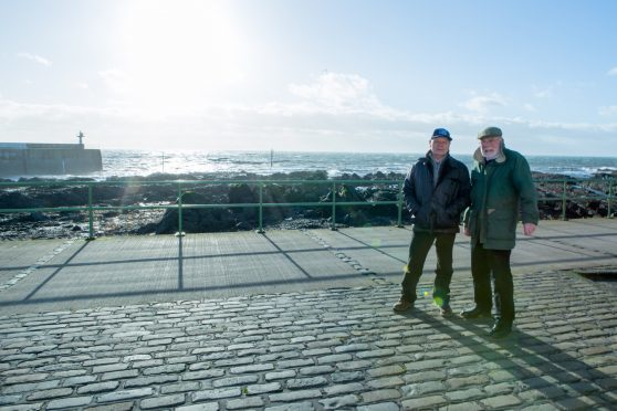 Former skipper Ronnie Hughes (69) and Wullie McNaughton (71) at Pittenweem harbour where the memorial to fishermen lost at sea is proposed to be located.