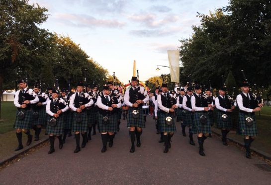 The Mackenzie Caledonian pipe band at the World Championships in June last year.