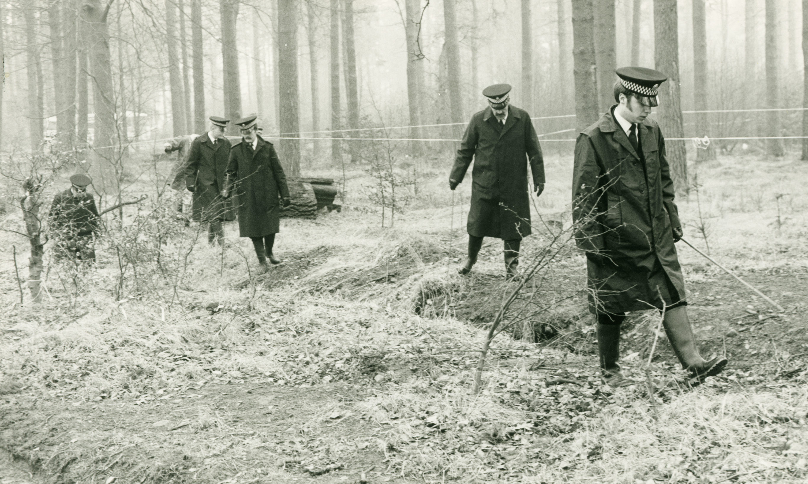 Police search Templeton Woods in 1979 following the murder of Carol Lannen.