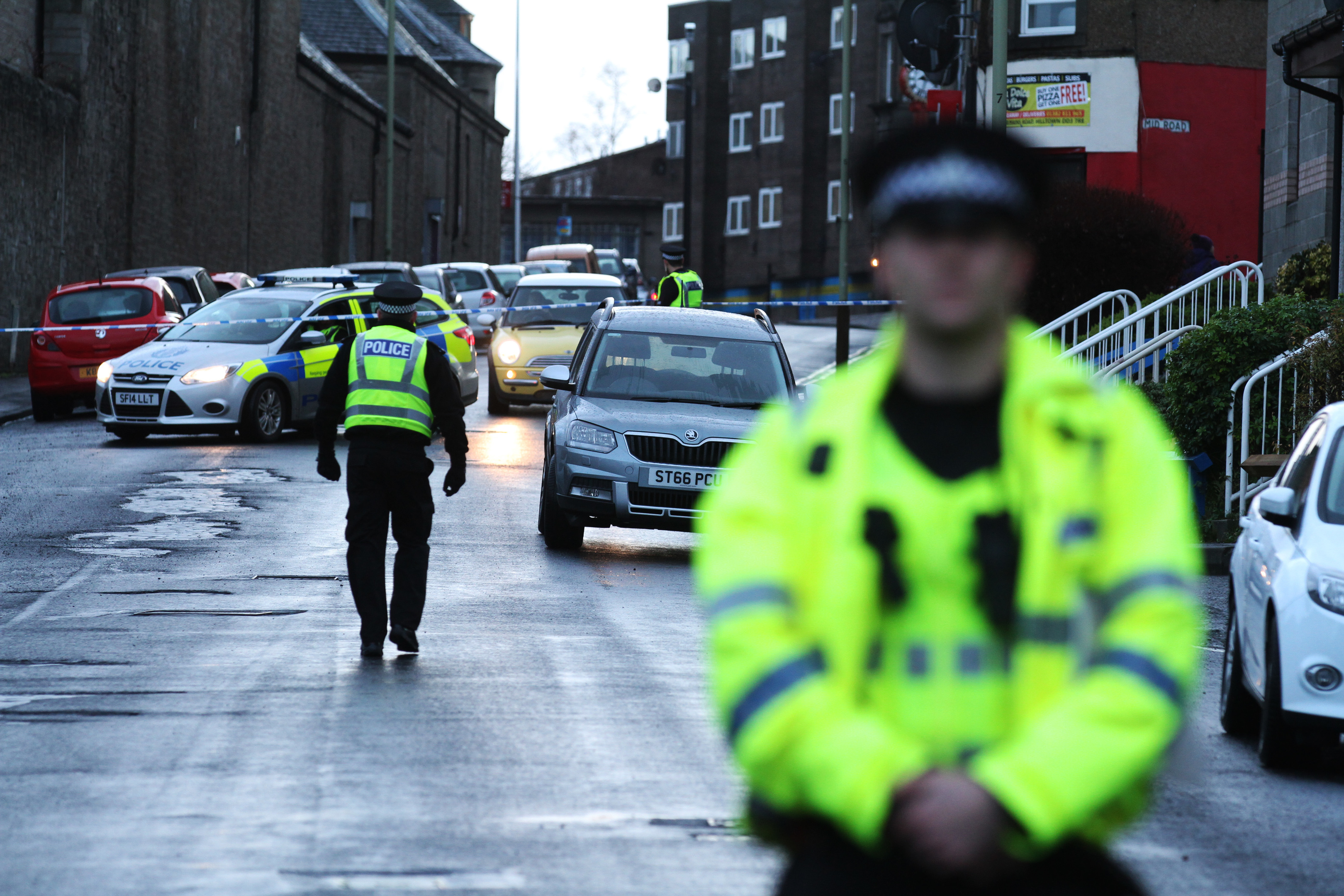 Police at the cordon on Mains Road, where John Ogston was found on New Year's Day.