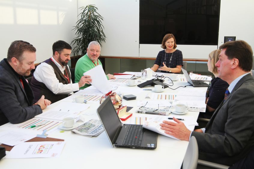 The judges meet to discuss the entries for the awards.