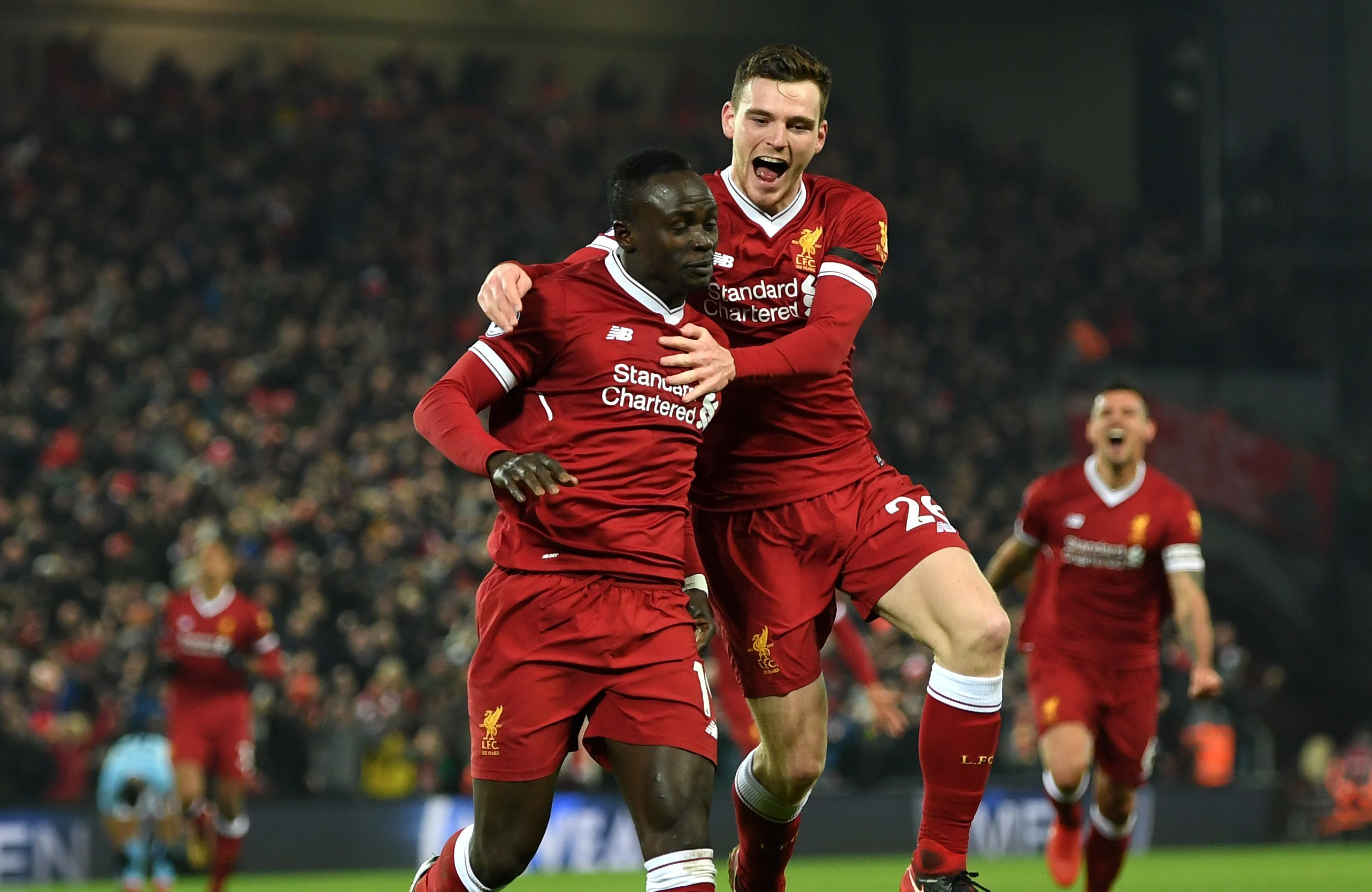 Liverpool scorer Sadio Mane is congratulated by Andy Robertson.