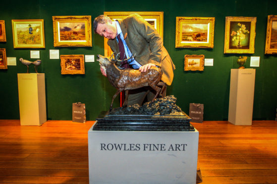 Glenn Rowles of Rowles Fine Art with a Stag bronze sculpture at a previous Galloway Antiques Fair.