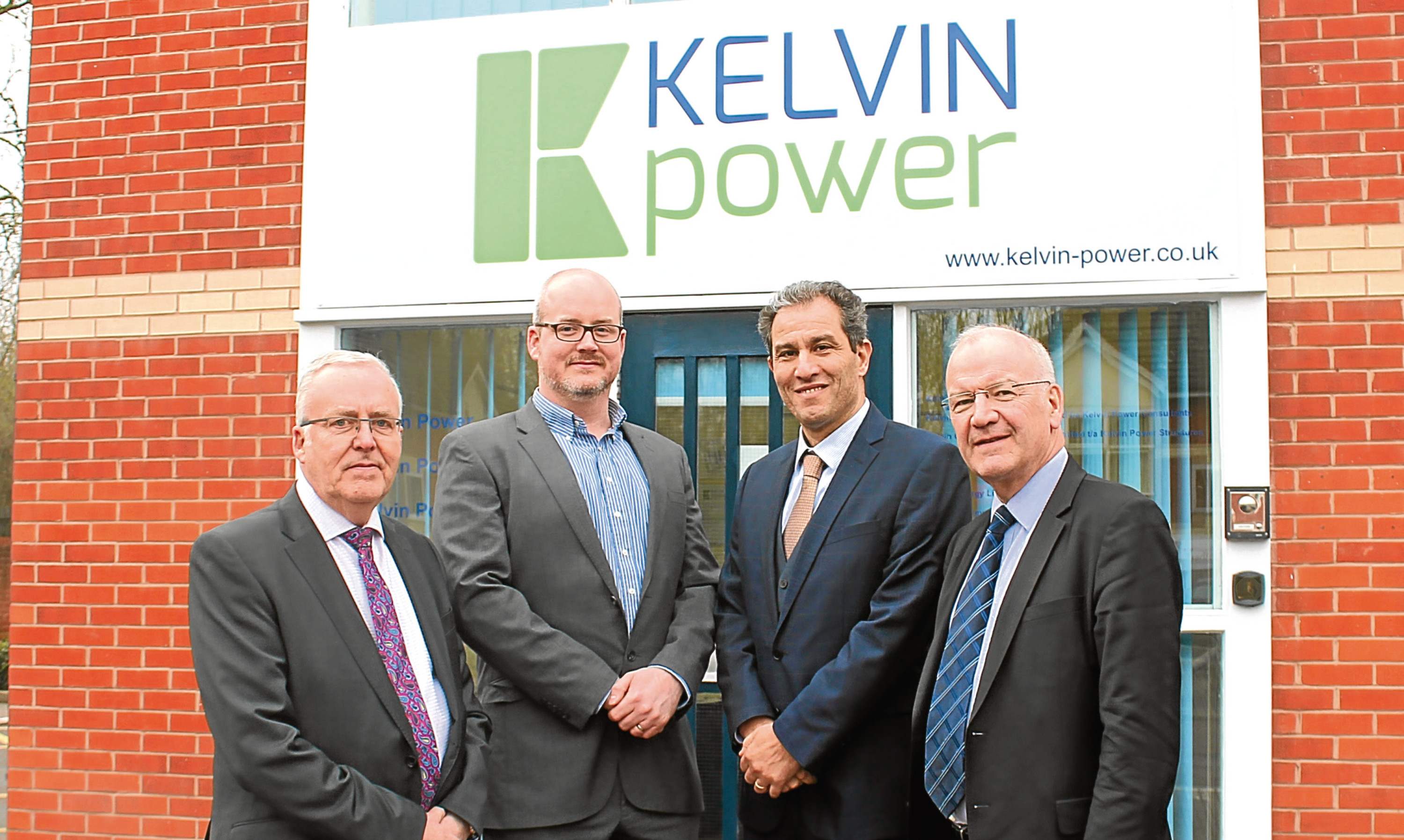 John Brennan and Alastair Brennan of Kelvin Power with VINCI Energies Rochdi Ziyat and Patrice Mantz.