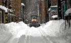 Life goes on in Montreal, Canda, after a harsh winter blast.