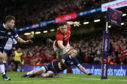 Steff Evans Scores Wales' fourth try in their 34-7 rout of Sxotland in Cardiff.