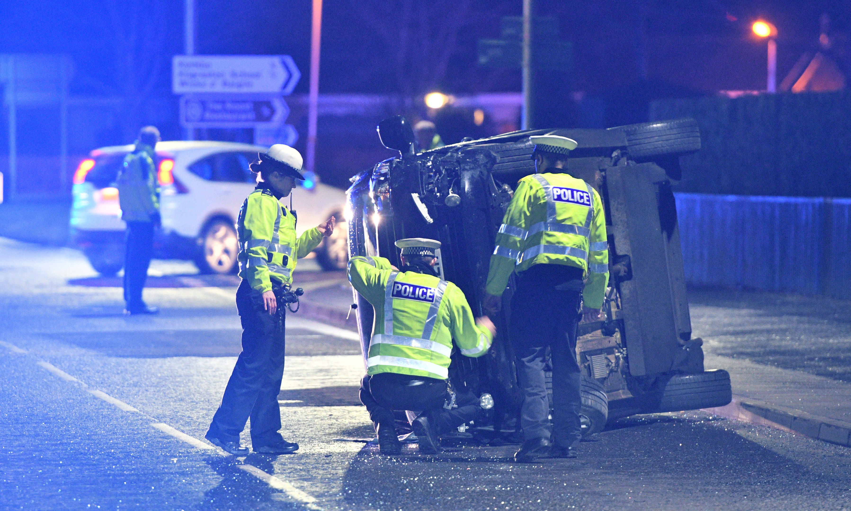 Police at the scene of the Bridge of Earn crash on Saturday, February 17