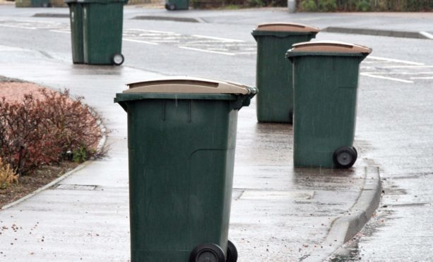Brown-lid bins wait for collection in Cedar Road, Perth.