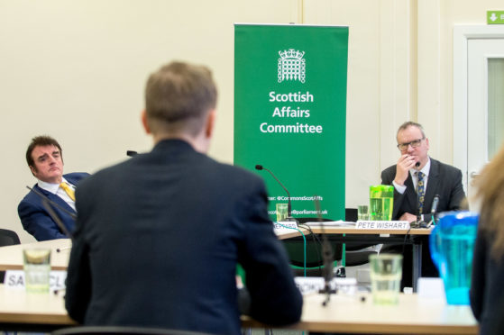 MPs Tommy Shephard and Pete Wishart hear evidence from Fife migrants.