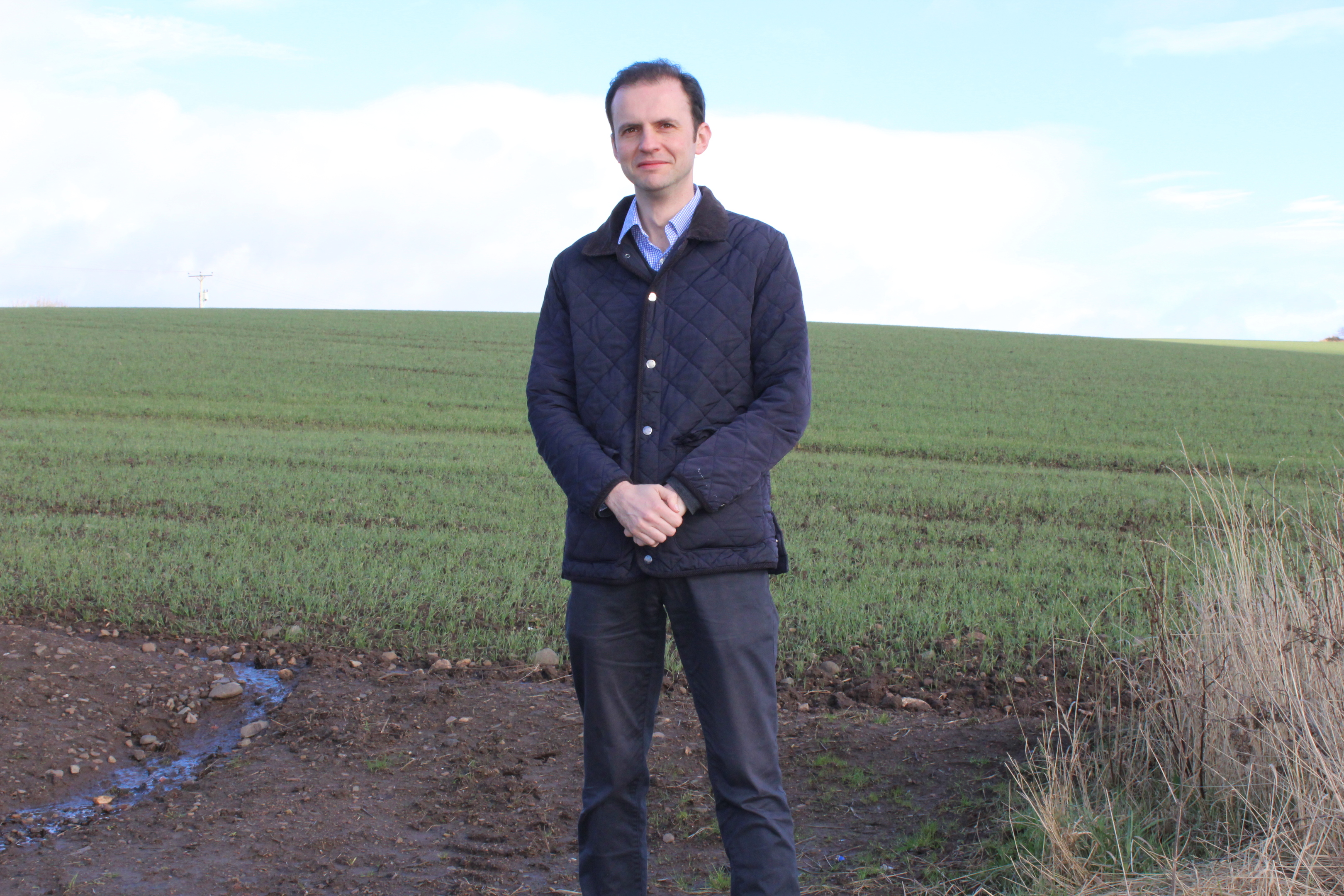 Stephen Gethins MP on the site of the proposed Cupar North development.