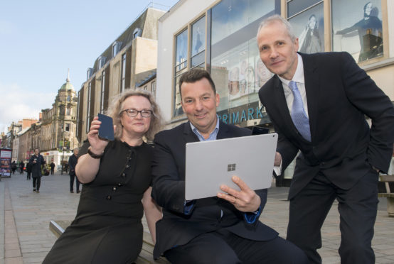 Event organiser Simon Baldwin (centre) with Leigh Brown of Association of Town & City Management Scotland and Stuart Black, director of Highland Council development & infrastructure.