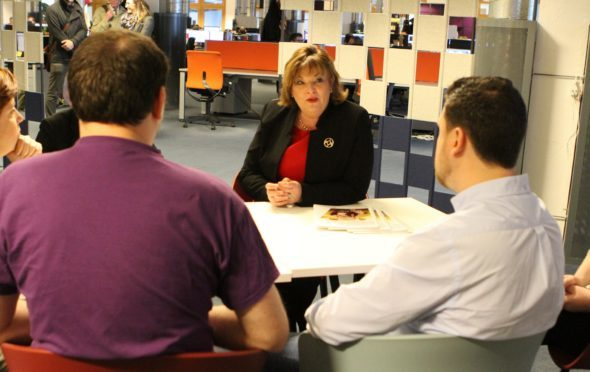 External Affairs Secretary Fiona Hyslop chats to staff of gaming company Outplay Entertainment at the Vision Building in Dundee's Greenmarket.
