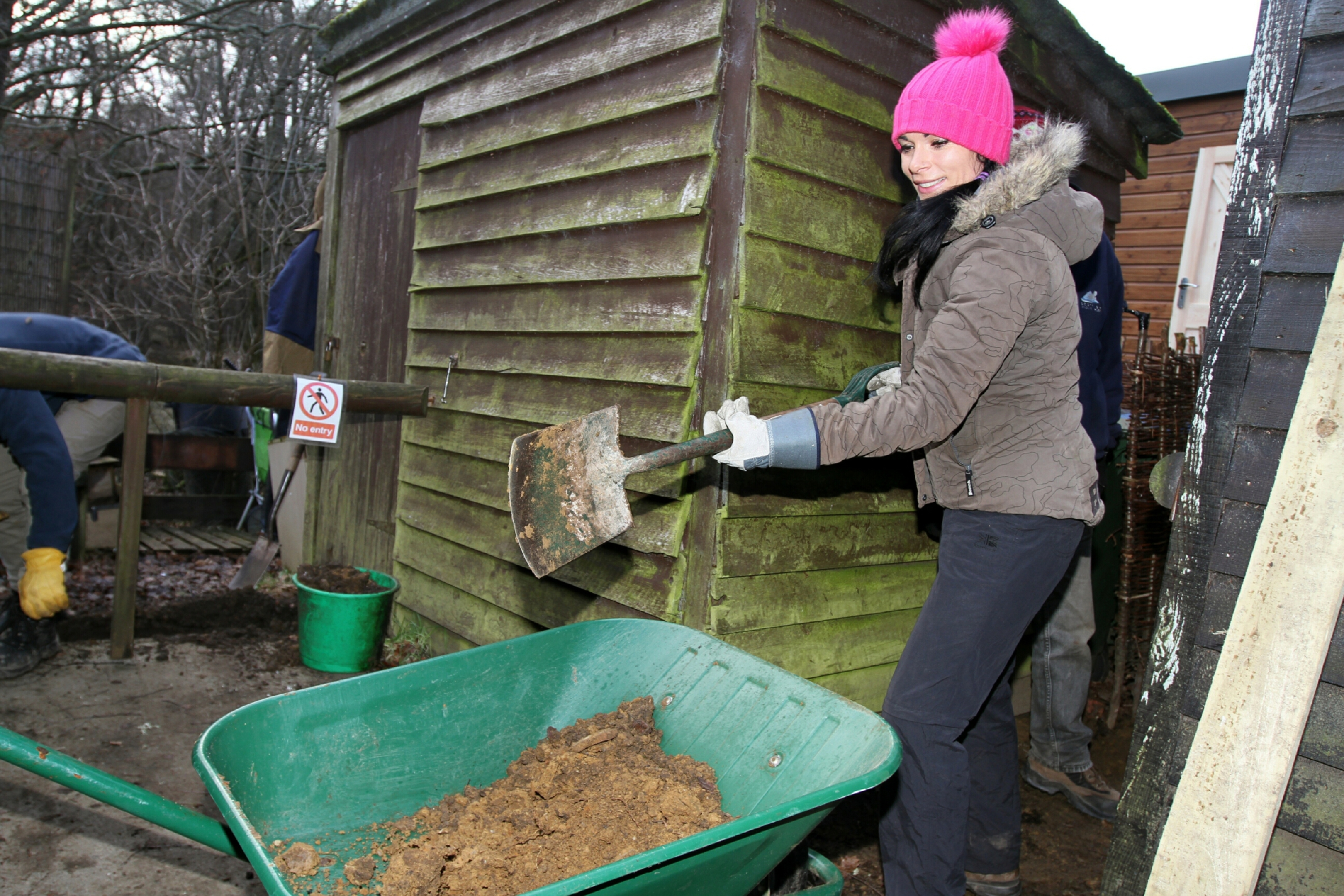 Gayle volunteers at Loch of the Lowes by helping to dig a trench for the new office.
