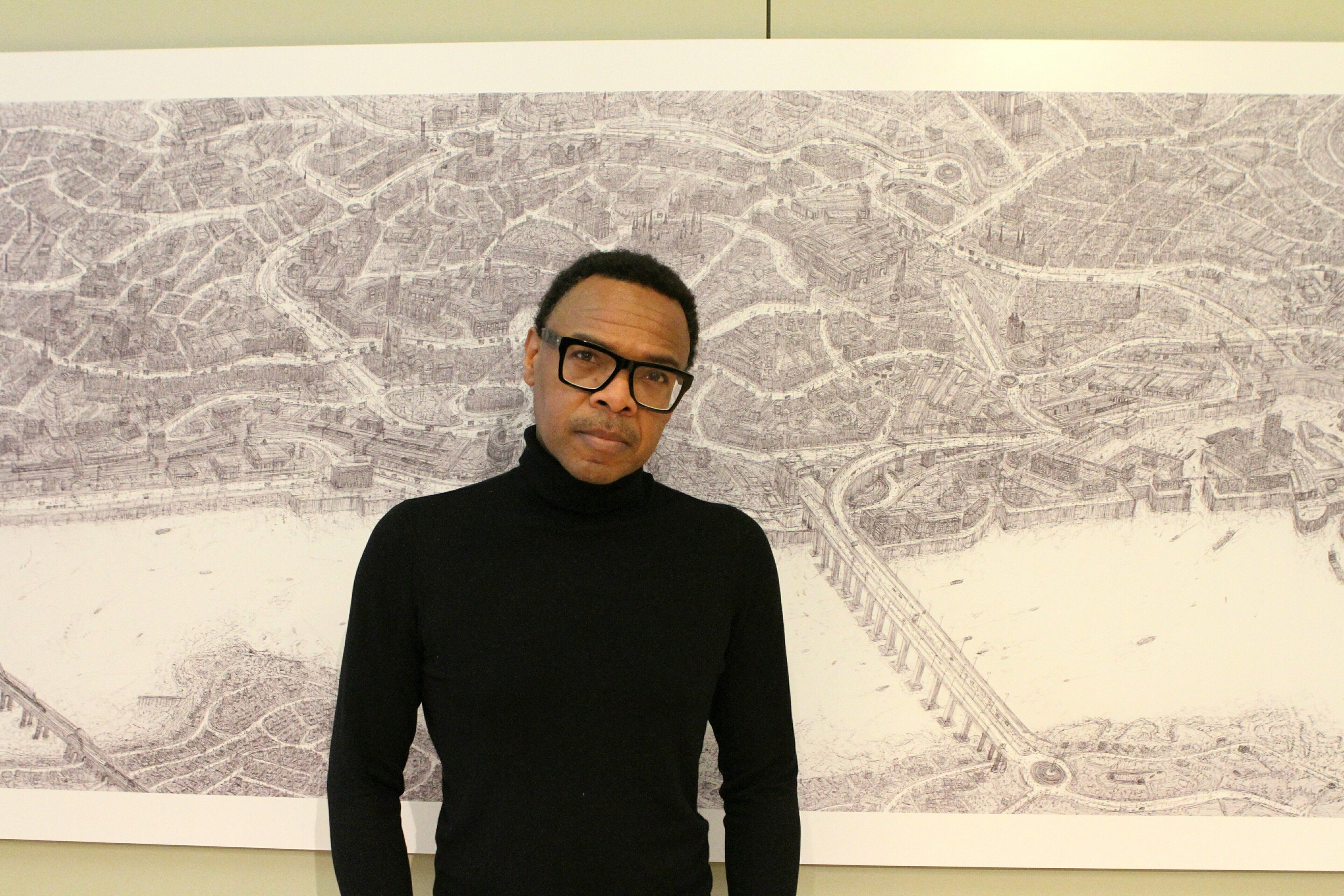 Carl Lavia with his sketch of Dundee.