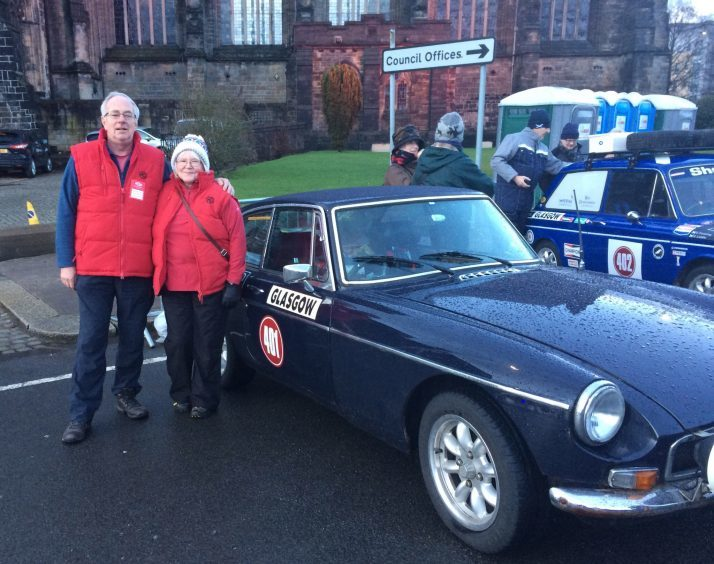 Dunfermline couple Jim and Norma Watson and their MG BGT