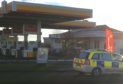 The scene at the Shell garage on Hendry Road.