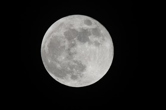 The rarity of a Blue Moon over Dundee on January 31. Taken by Courier photographer Kim Cessford.