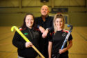 Sam Sangster and Jess Ross from Dundee Wanderers Hockey Club with Richard Kilcullen, the managing director of Kilmac.