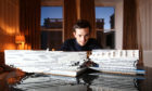 Brian McNicoll with his model of V&A Dundee.