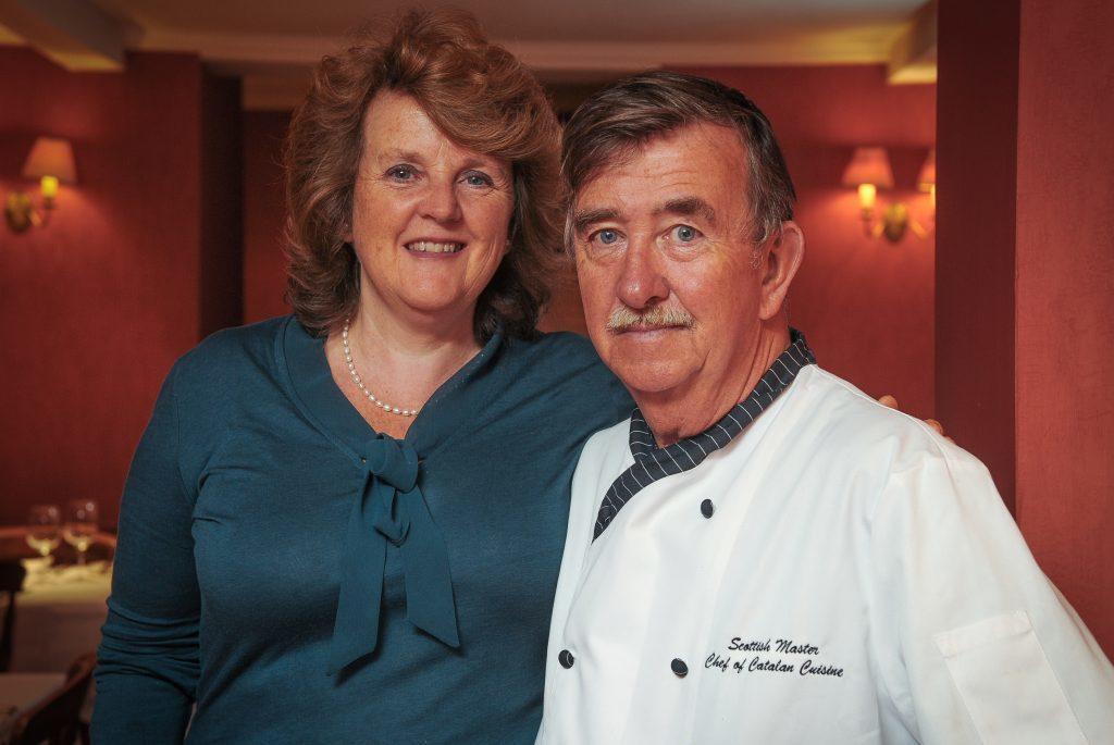 Amanda and Jimmy Graham inside their restaurant