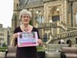 Pru Watson with this year's festival programme,