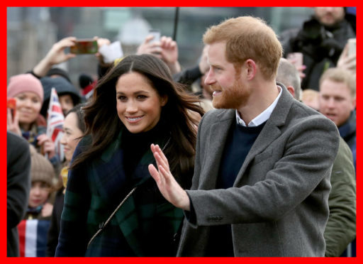 Prince Harry and Meghan Markle during a walkabout on the esplanade at Edinburgh Castle.