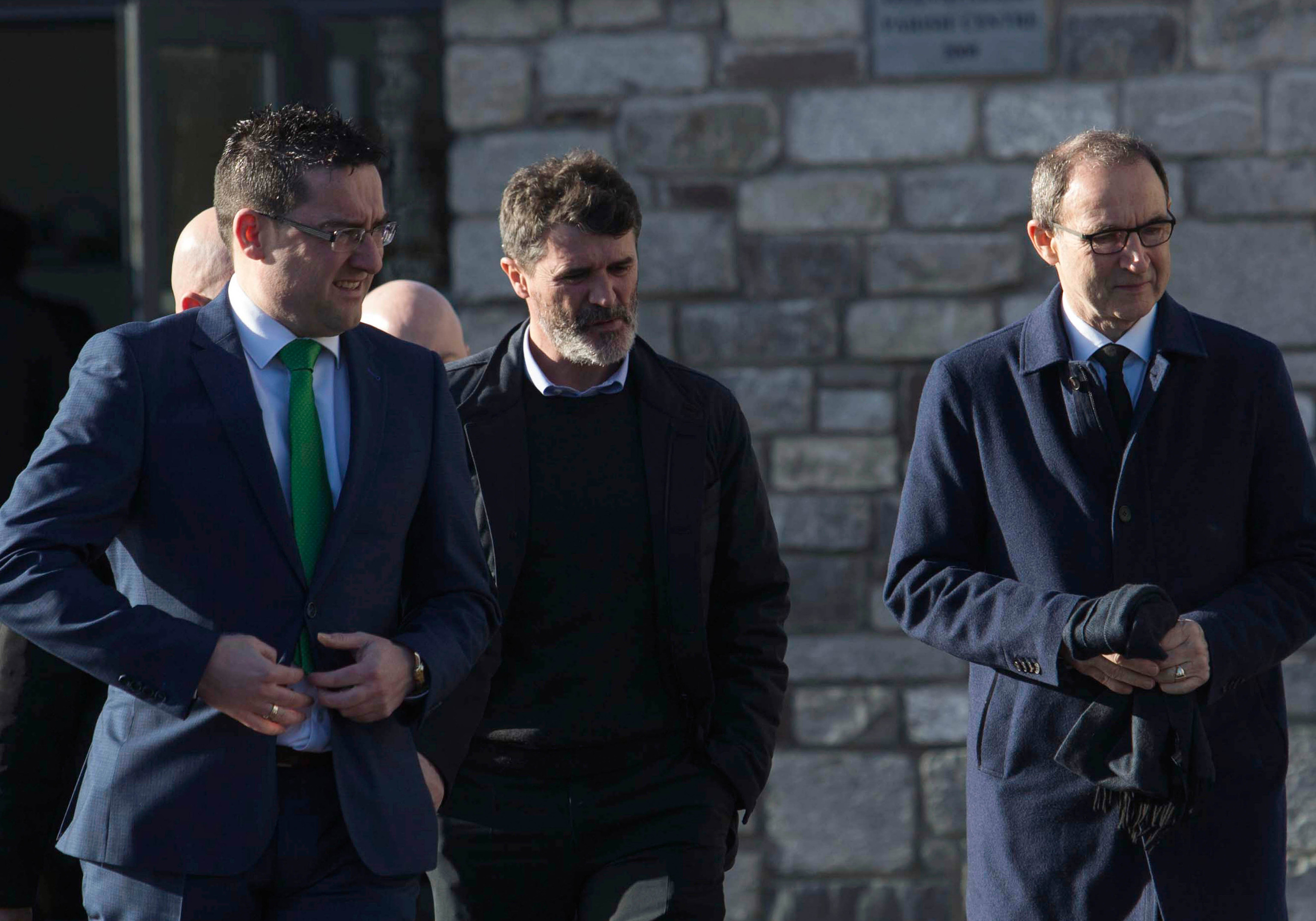 Roy Keane (centre) and Martin O'Neill (right) arrive for the funeral of former Celtic and Manchester United footballer Liam Miller.
