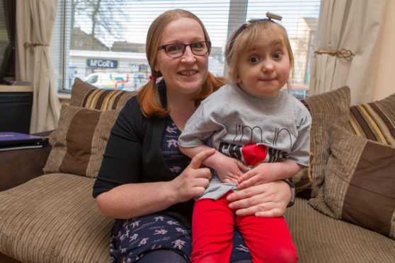 Mum Leanne Howie (pictured with daugher Robyn) is now approved to teach Makaton sign language