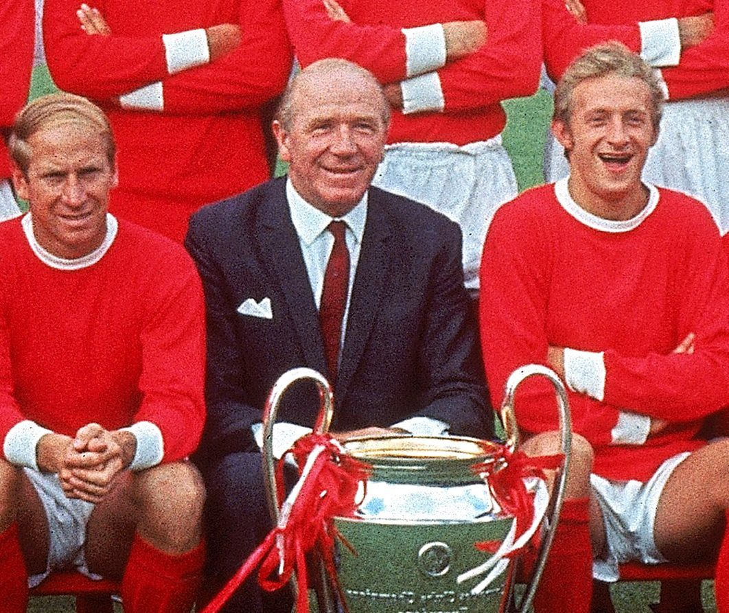 Sir Matt Busby next to two of his legendary Manchester United players.