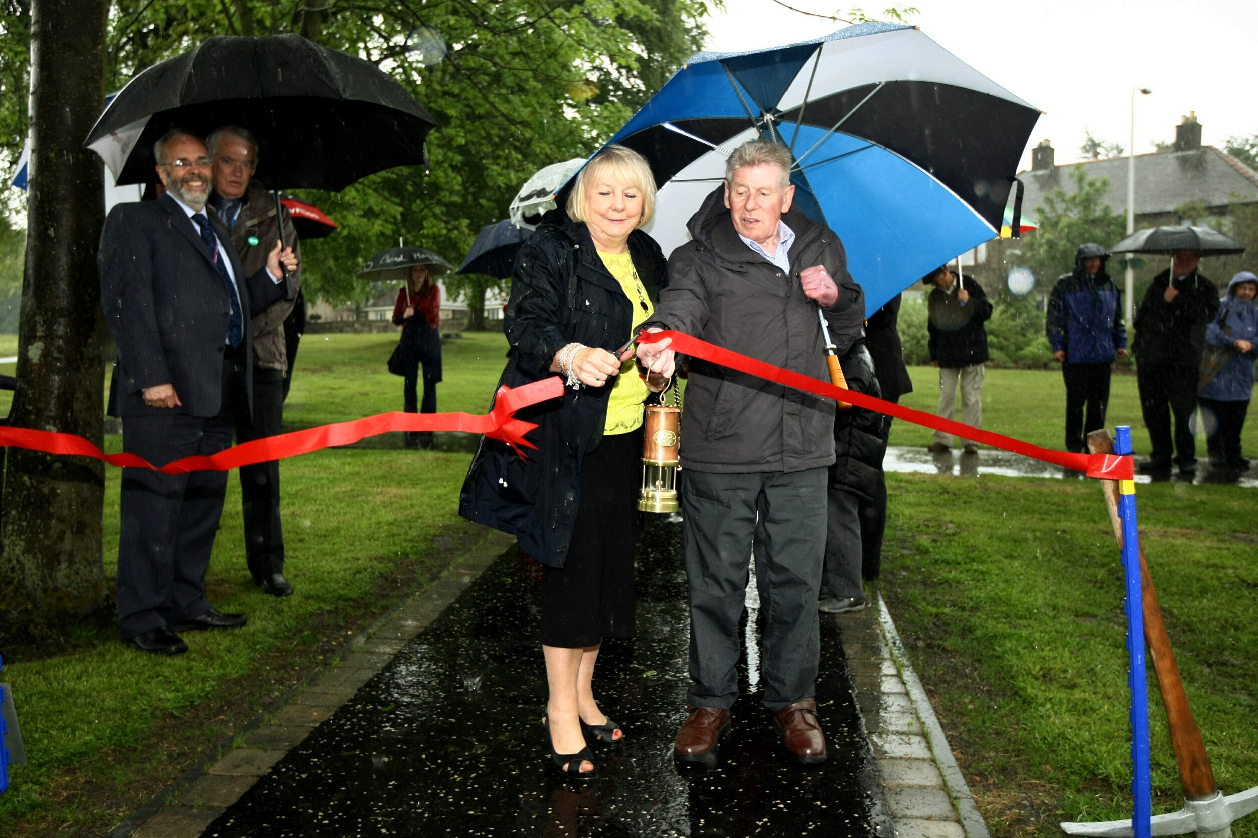 Councillor Helen Law and Joe Miller, the old plugline driver opens the first phase of the garden in 2014