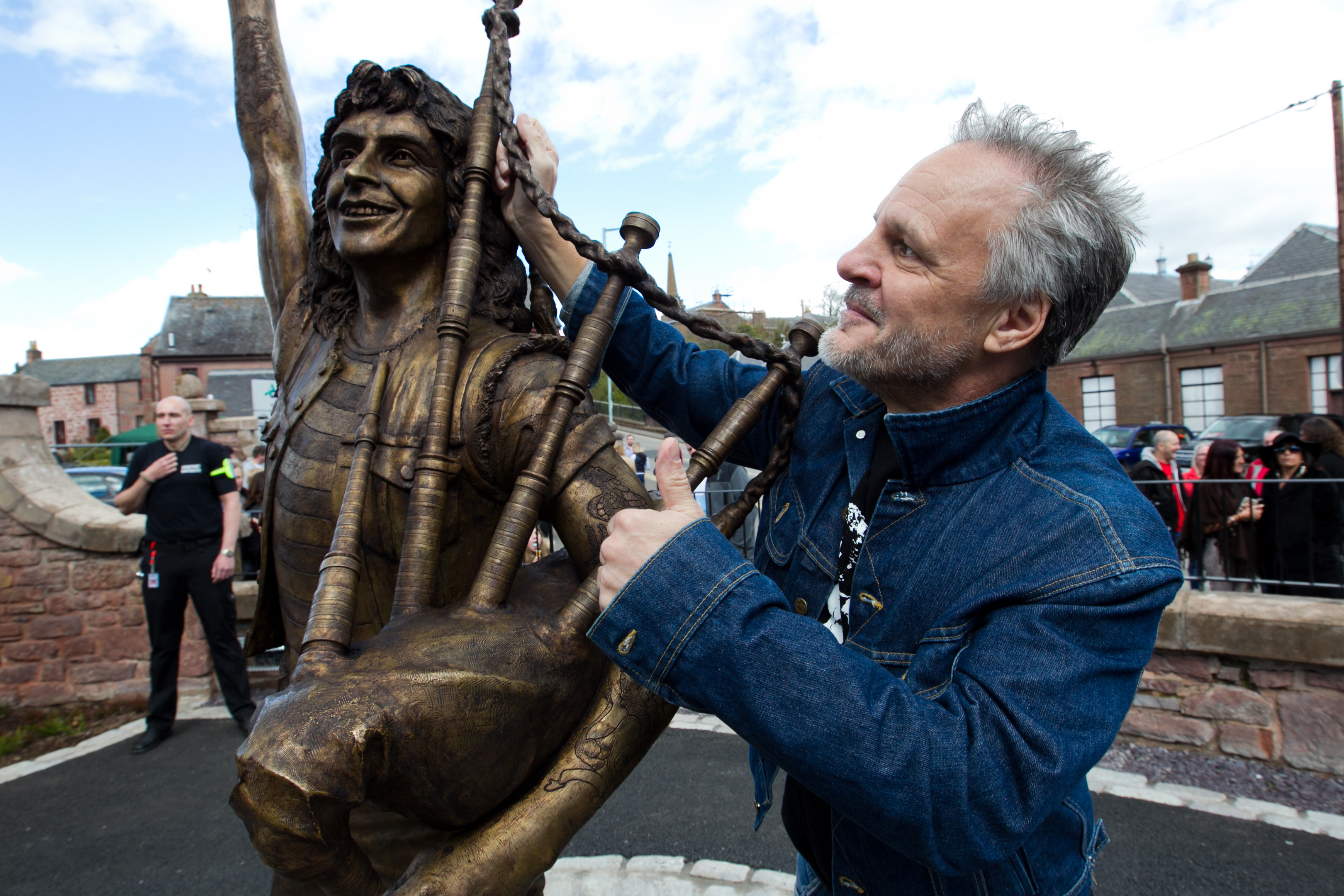Former AC/DC bassist Mark Evans at the Bon Scott statue in Kirriemuir two years ago.