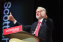 Labour leader Jeremy Corbyn acknowledges delegates' applause before giving his keynote speech to the Scottish Labour Party Conference at the Caird Hall on March 9 2018 in Dundee.