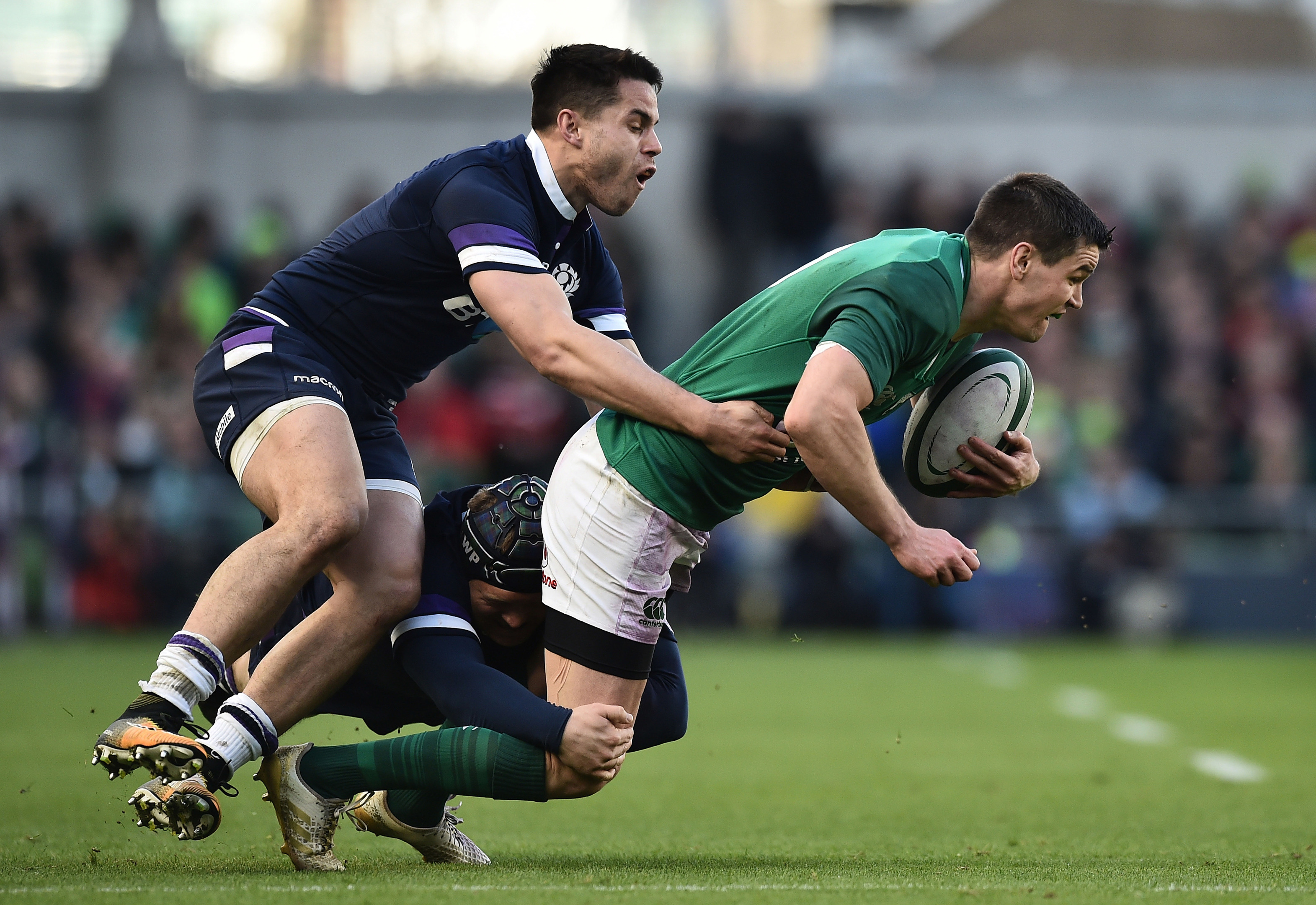 Sean Maitland tackles Johnny Sexton during Saturday's 6 Nations clash in Dublin.