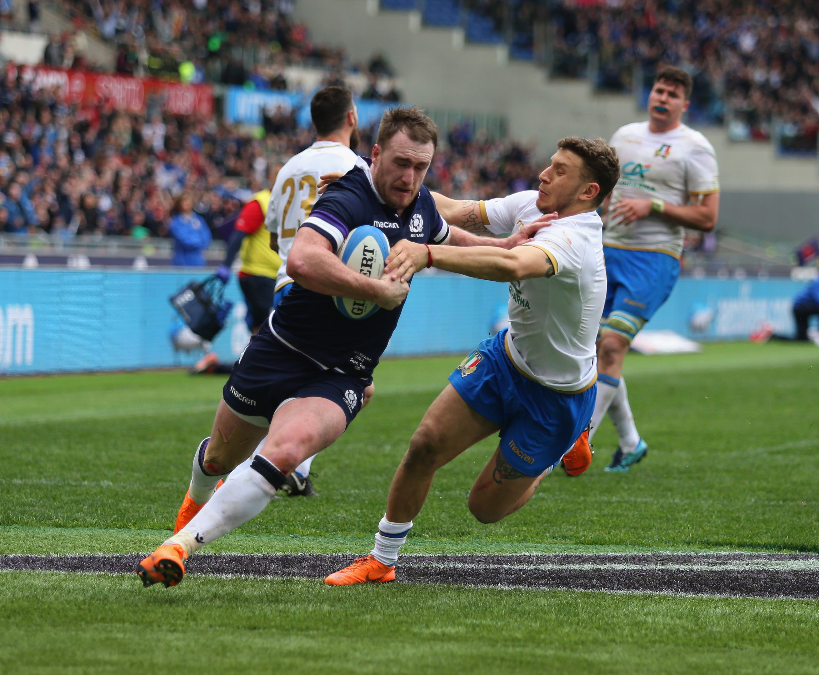 Stuart Hogg scores the Scotland's fourth try against Italy in Rome.