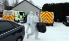 Forensic officers in Hazel Court, Alyth, the scene of the alleged murder of Dundee man John Donachy.
