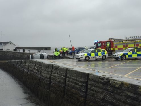 Emergency workers at the scene on Saturday (Picture by Paul McGillvery)
