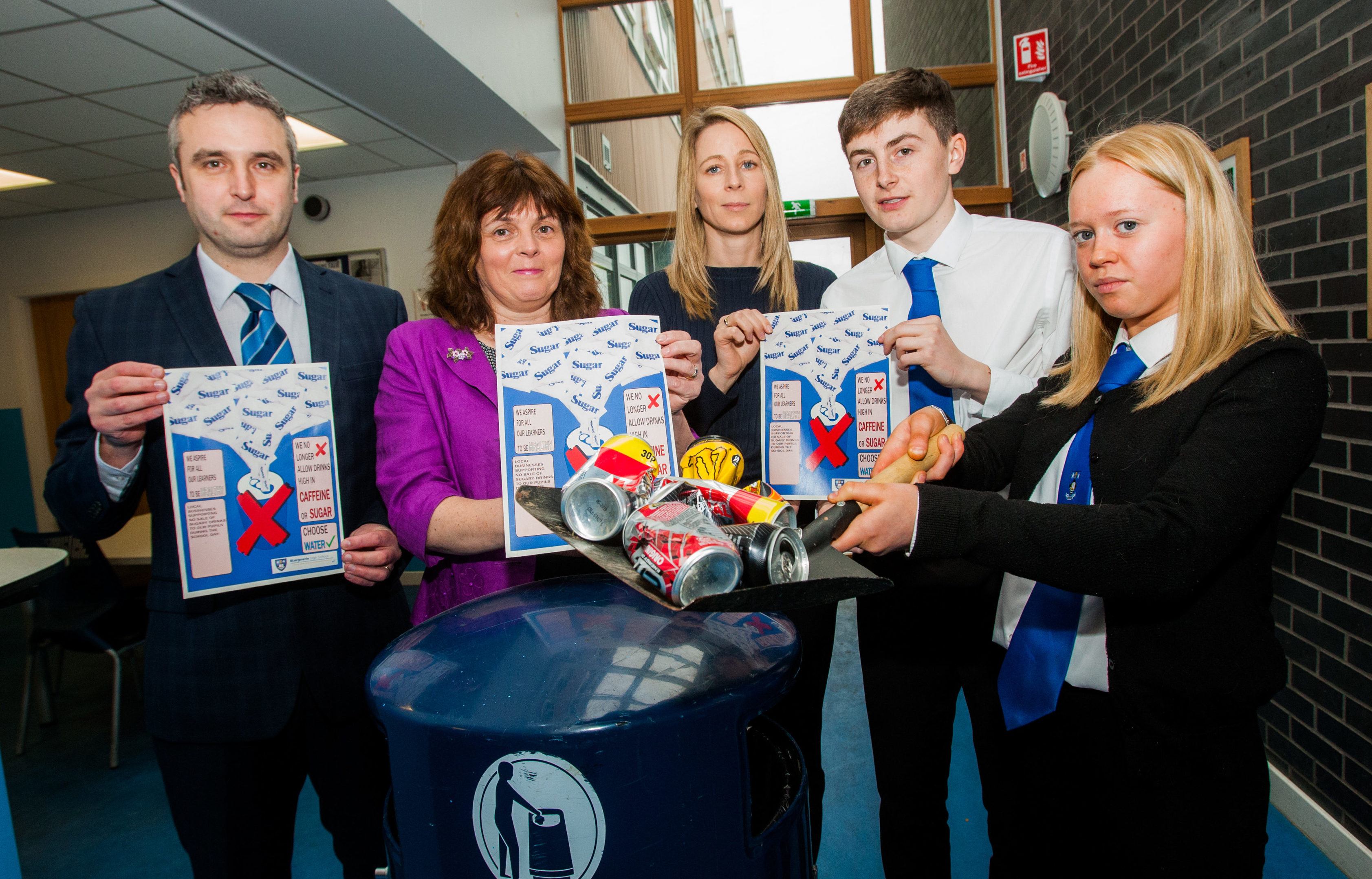 Left to right is Deputy Head Teacher Andy Dingwall and Head Teacher Bev Leslie, Laura Jane Grant (Principal Teacher of Science), Rhys Fraser (6th year) and Emily Downham (6th year).
