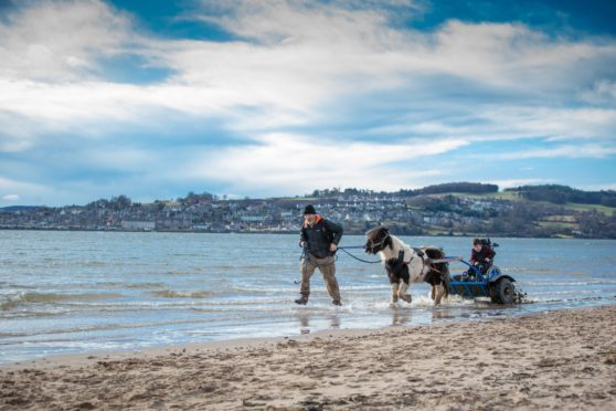 Simon and Obama taking 10-year-old Kevin for a ride on Broughty Ferry beach.