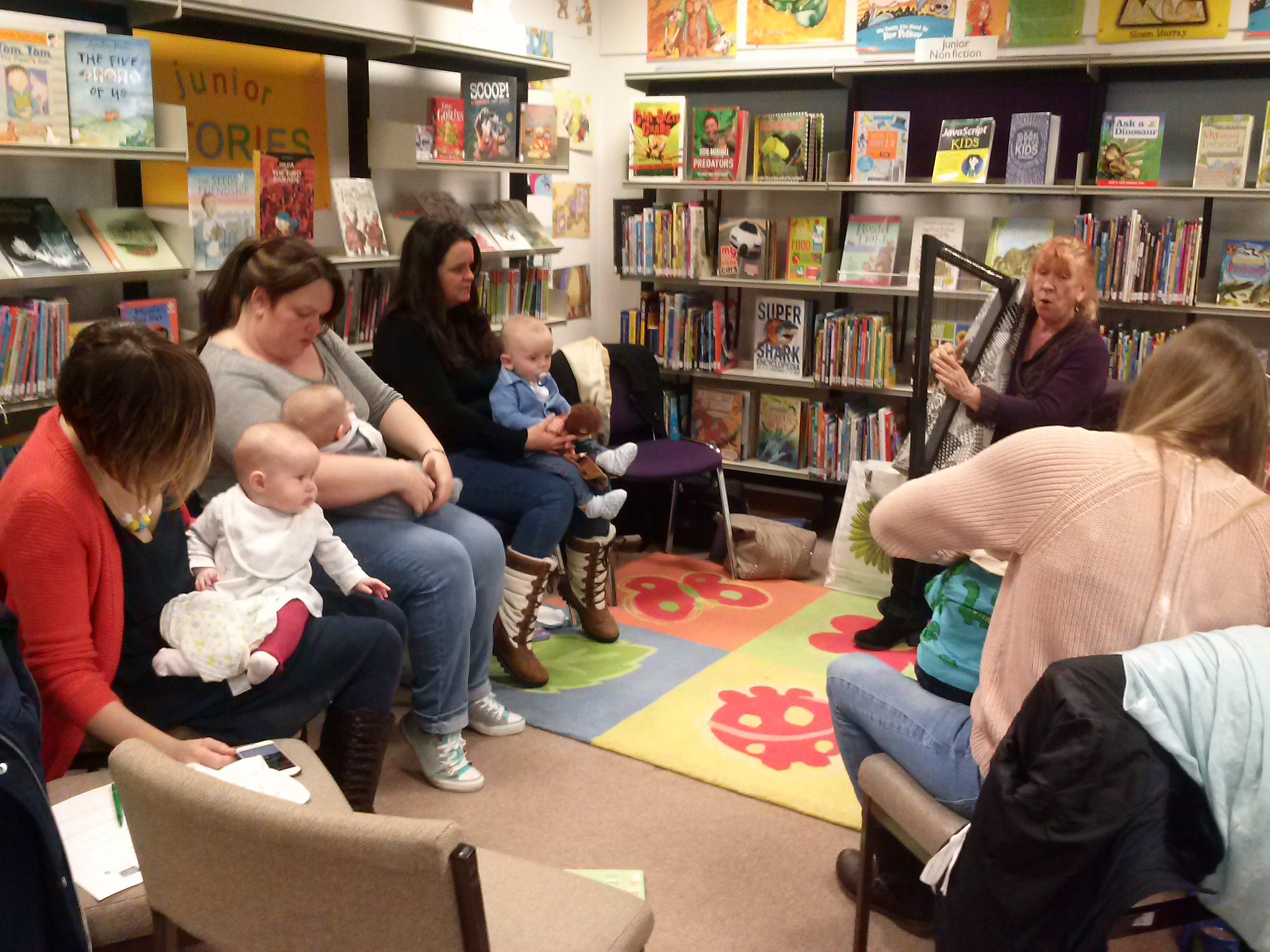 Irene Watt plays the harp for mums and babies at one of the lullaby sessions