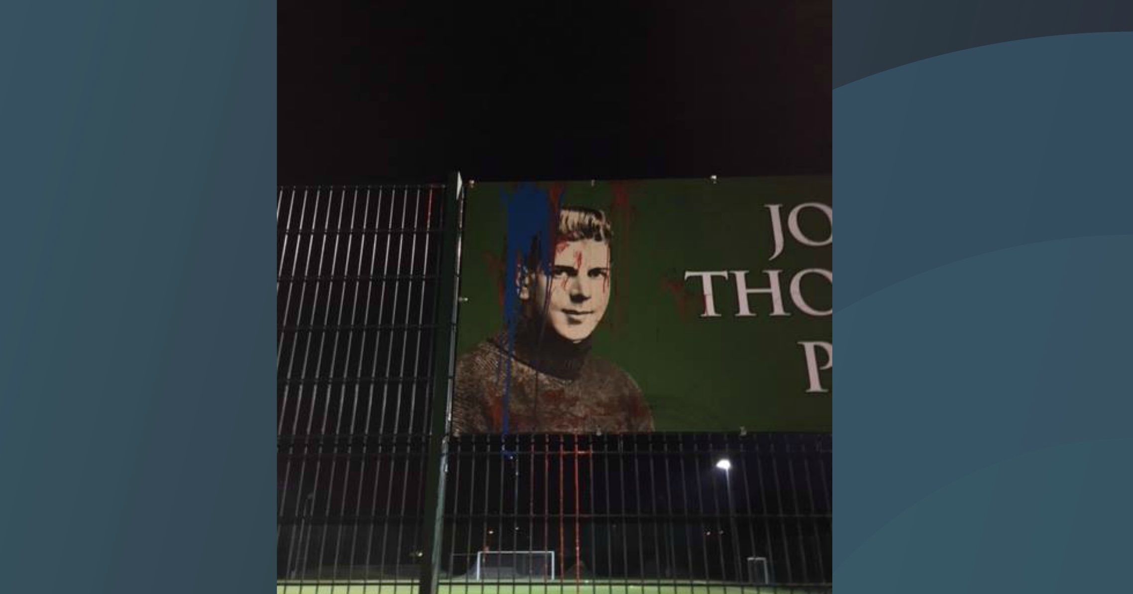 Vandals daubed blue and red paint on the pitch and sign