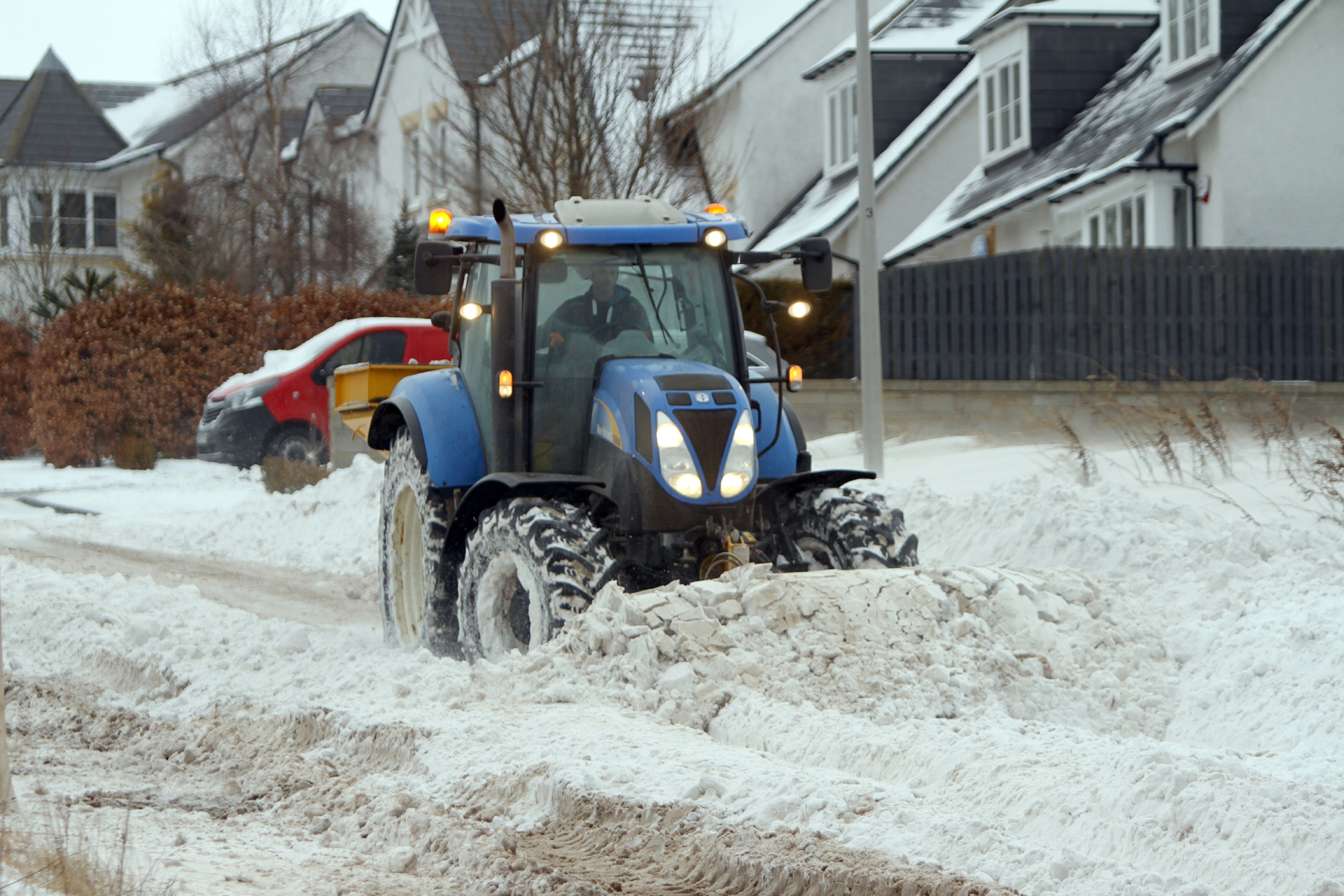 Tractors helping to clear snow on Balmossie Brae in Dundee.