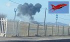A photo issued by Sian Rebecca Williams of smoke rising after a Red Arrows jet crashed following an incident at RAF Valley in north Wales. Inset: a Red Arrows jet.