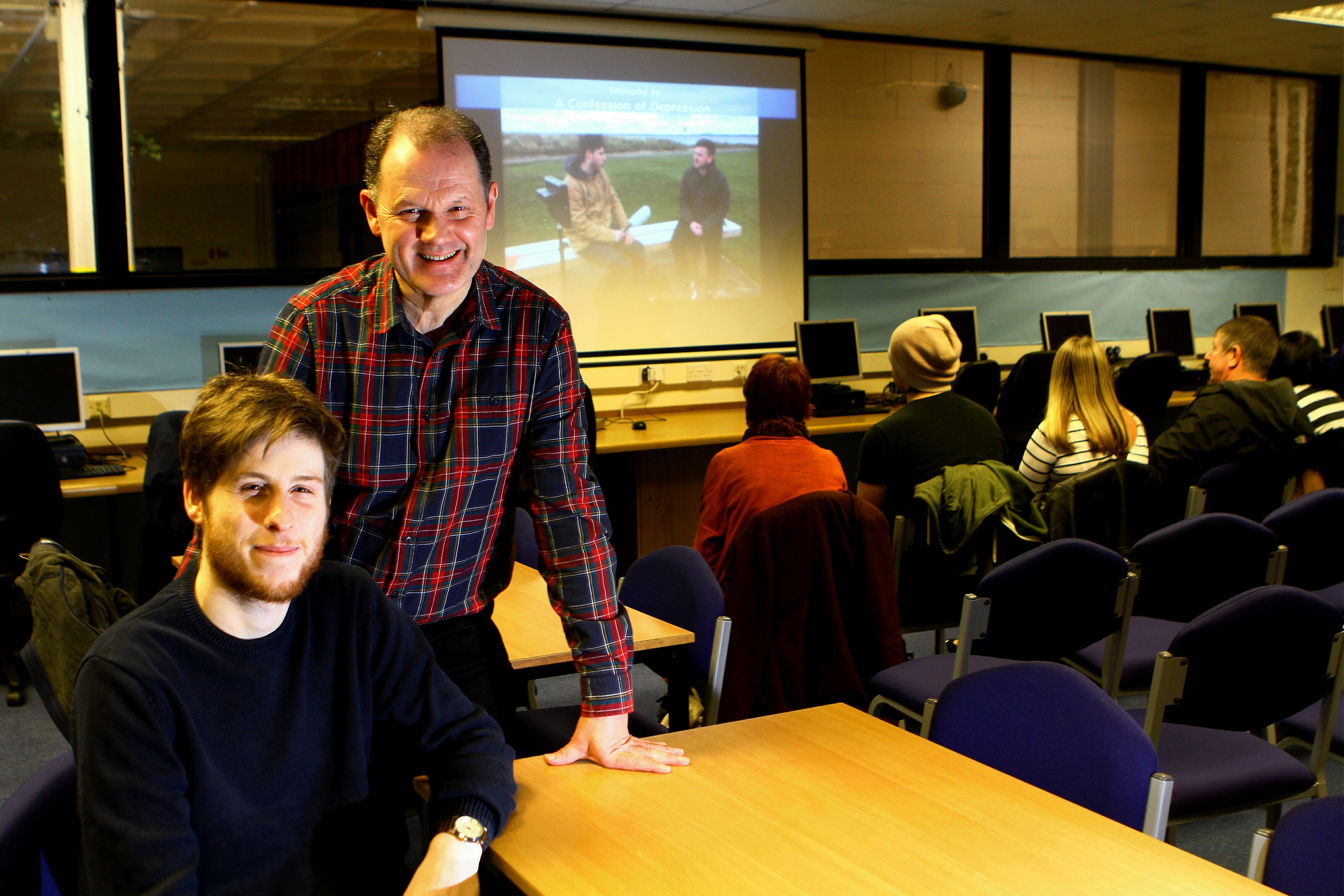 Cllr Ben Lawrie, seated, and documentary director Stuart Burns before the showing of their film A Confession Of Depression at Monifieth High School.